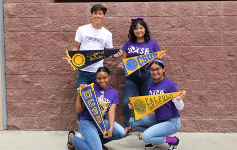 Seniors  pose with their respective college flags.