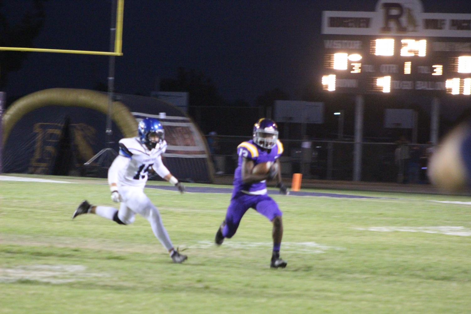 Zion Hall runs with the ball against Frontier player during a home game.