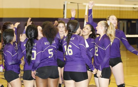 The Varsity girls volleyball team gets ready for their home game.