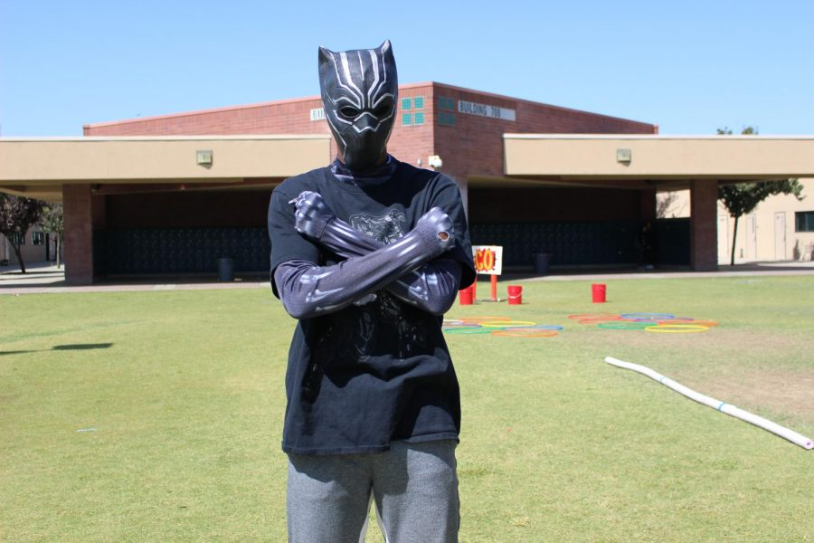 A student dressed as Black Panther poses for Superhero Day.
