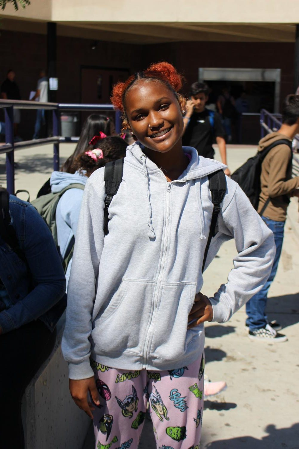 A student smiles as she wears a cute outfit for Dress Like A Little Kid Day