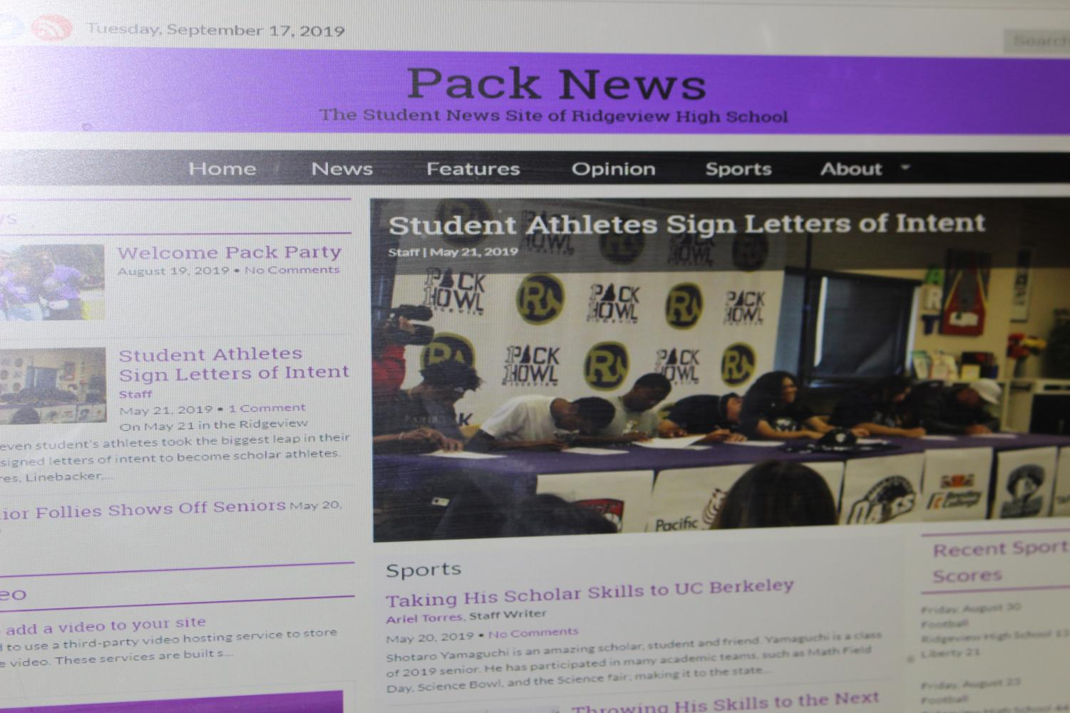 A computer screen shows the new Journalism website for Ridgeview High.
