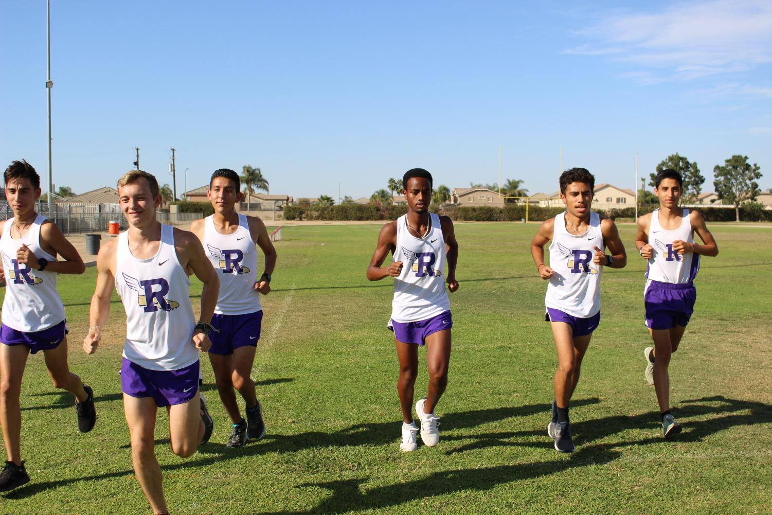 Returners form the state championship cross country team practice at Ridgeview.