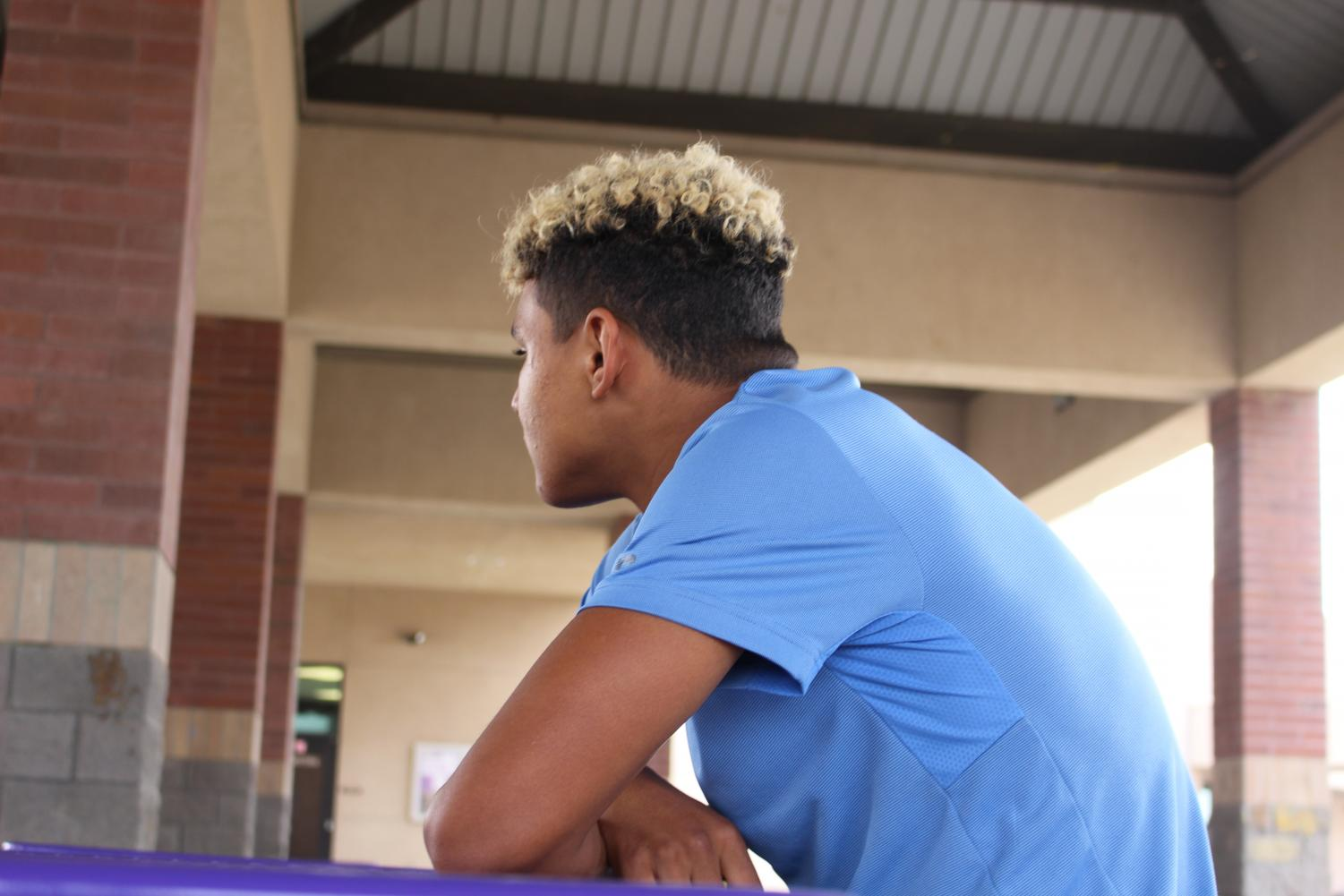 Alex Bryd looks off in the distance at Ridgeview High .