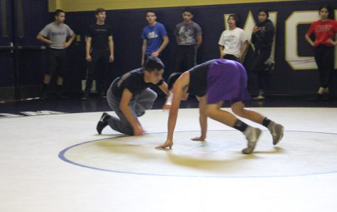 Boys wrestlers Jacob Maradiaga and Chris wrestler during a recent practice.