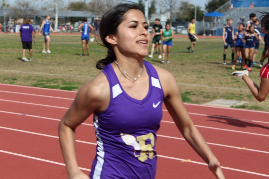 Mikalya Polanco finshes her race during a track meet.