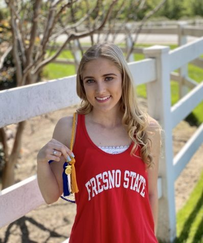 Senior, Taylor Jones poses with her FFA cord along with her Fresno State gear.