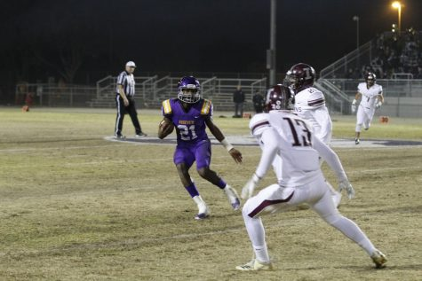 Jaron Amos runs with the ball against Independence High School last year.