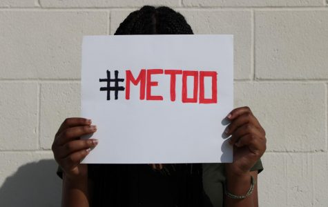 A person holds a Me Too sign which has gained  attention in the media.