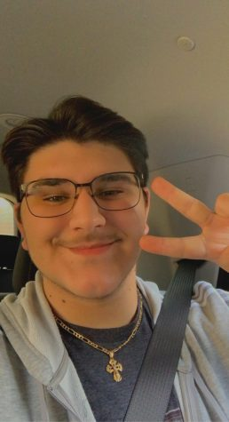 Gabriel Abboud smiles and gives the camera a peace sign.