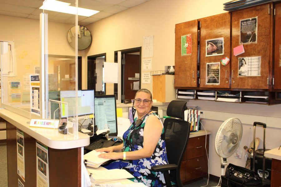 Ghada Akroush sits at her desk in the Deans office.