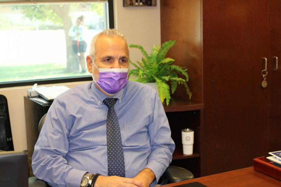Principal Roger Sanchez poses at this desk in his office at Ridgeview High.