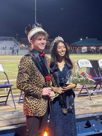 Homecoming King Jeffrey Wilson and Queen Mone Rocha pose after hearing they won.